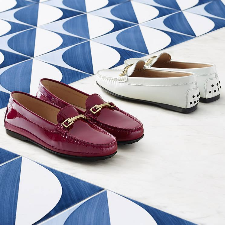 FOR HER - An exquisite geometric accessory embellishes these patent leather loafers with their bold look: the Tod's saddlery-inspired metal buckle.