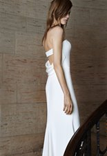 Featuring the ODELLE gown  Ivory strapless soft mermaid silk crepe gown with cut-out back and cowl detail.